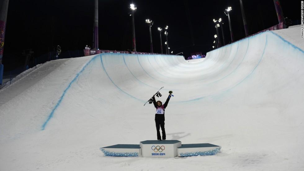 Halfpipe gold medalist Iouri Podladtchikov celebrates on the podium after the flower ceremony on February 11.