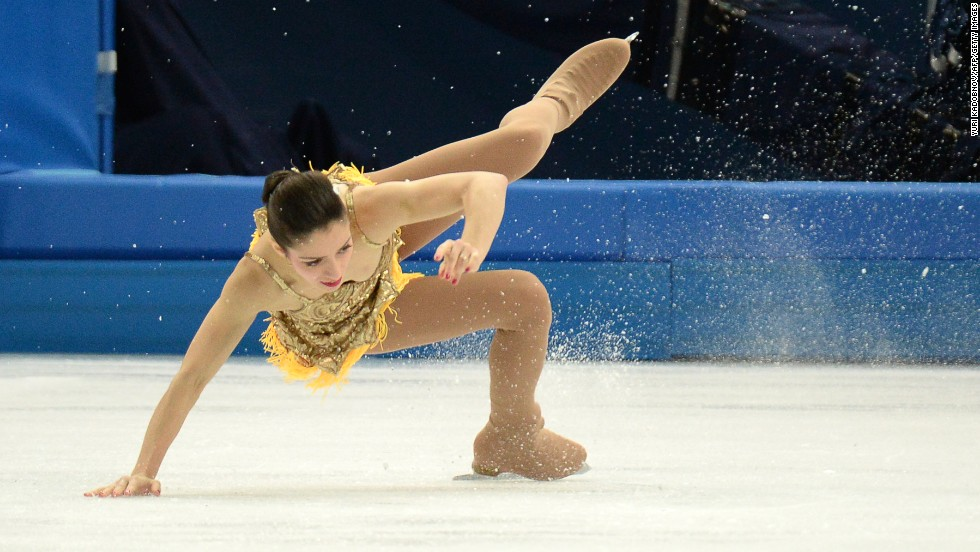 Italy's Stefania Berton falls as she performs in pairs figure skating on February 11.