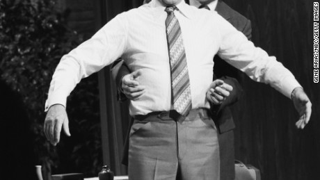 Henry Heimlich demonstrates the  maneuver on Johnny Carson in 1979.