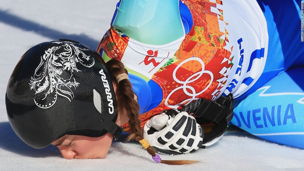 Slovenian skier Tina Maze kisses the ground after her downhill run on February 12.