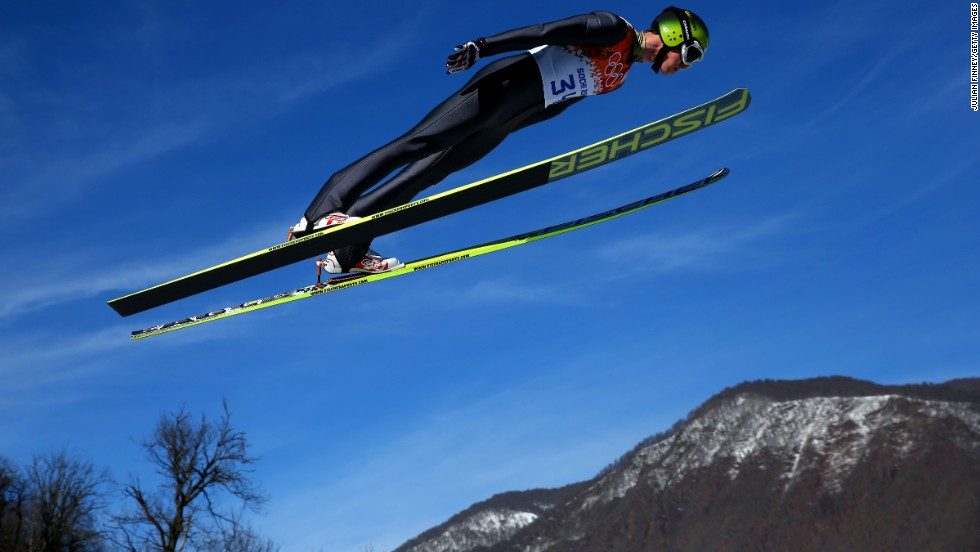 Tim Hug of Switzerland completes a trial jump during the normal hill Nordic combined event on February 12.