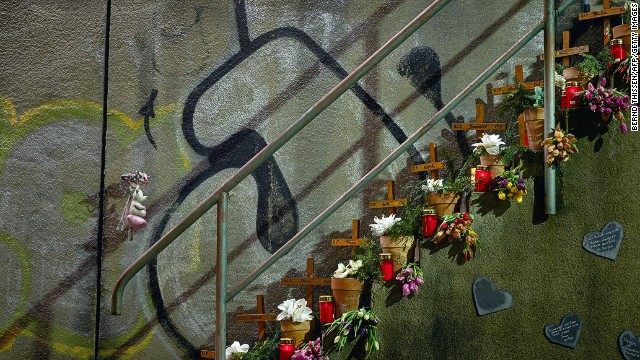 Tributes are laid on February 10, 2014 at the site where 21 people died at the Love Parade in Duisburg, Germany.