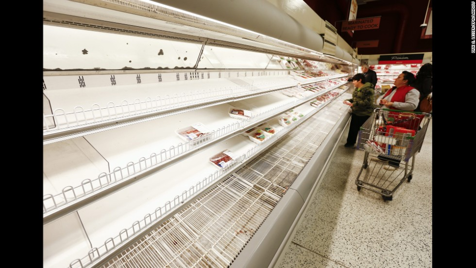 People shop for what is left at a Publix grocery store in Decatur, Georgia, on February 11.