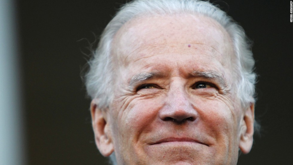 Joe Biden smiles on the steps of the State House in Concord, New Hampshire, in September 2012.
