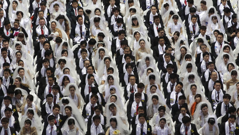 "FEBRUARY 12 - GAPYEONG, SOUTH KOREA: Some 2,500 South Korean and foreign couples exchange or reaffirm marriage vows in a mass wedding ceremony arranged by Hak Ja Han Moon, the wife of the late Rev. Sun Myung Moon, the<a href=""http://edition.cnn.com/2012/09/02/world/asia/south-korea-reverend-moon-dead/""> controversial founder of the Unification Church</a>."