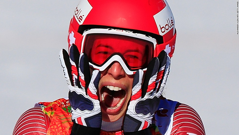 Swiss skier Dominique Gisin reacts after finishing her run in the downhill event February 12.