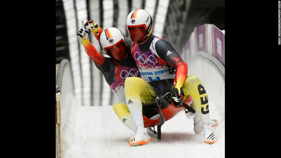 Germany's Tobias Arlt and Tobias Wendl celebrate their win in luge doubles on February 12.