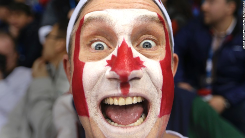 Benoit Lamy shows his support for Canada during the women's hockey game against the United States on February 12.