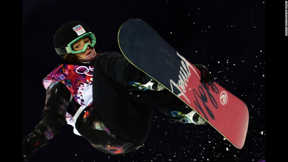 Sarka Pancochova of the Czech Republic grabs her snowboard in the halfpipe event February 12.
