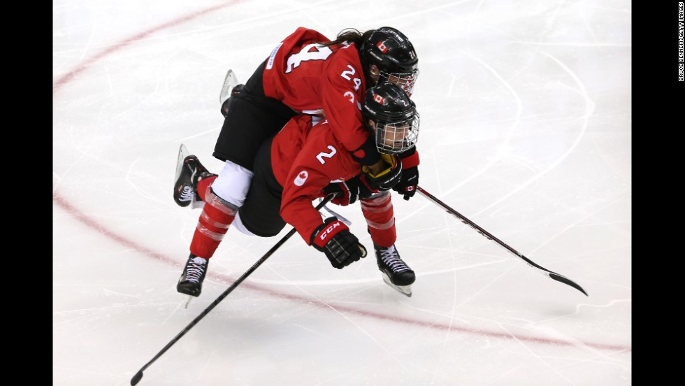Canadians Natalie Spooner, top, and Meghan Agosta-Marciano celebrate Spooner's third-period goal against the United States on February 12.