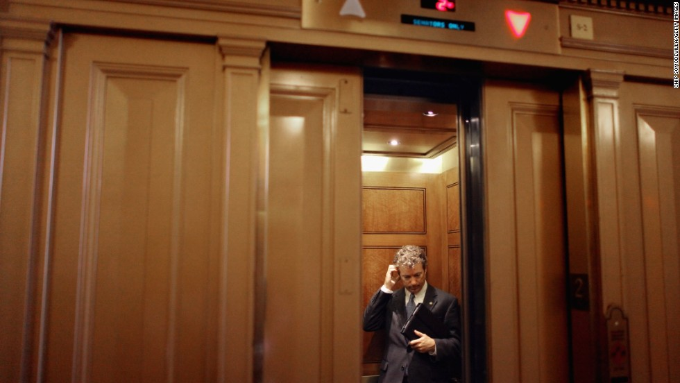 Paul boards an elevator after attending a Republican caucus meeting in Washington in July 2011.