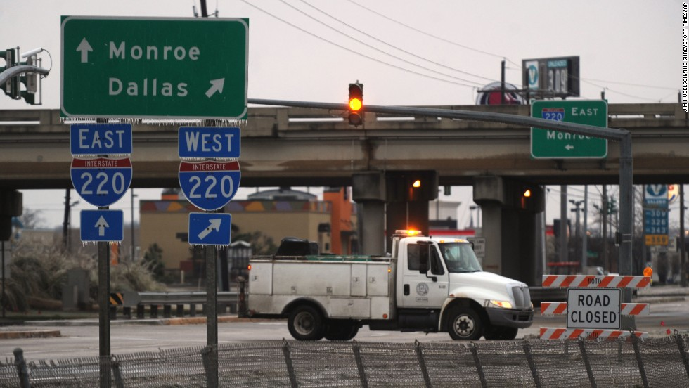 A truck in Bossier City, Louisiana, blocks access to Interstate 220, which was closed because of icy conditions on February 12.