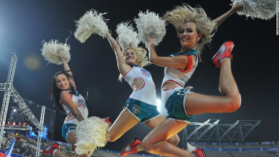 Other supporters adopt an American look, like these cheerleaders at a match between Deccan Chargers and Kings XI Punjab.