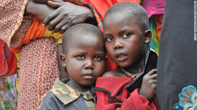 Children wait in front of the Bangui air force base for their evacuation to Chad on February 6, 2014.
