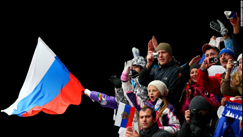 A fan waves a Russian flag after the luge doubles on February 12.