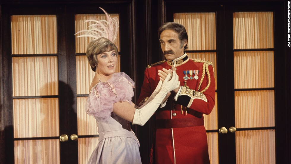 "Julie Andrews co-stars with Caesar in an episode of ""The Julie Andrews Hour"" in 1972."