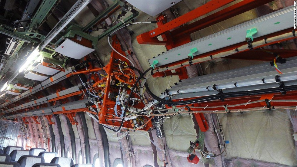 Instead of passenger seats, this aircraft is filled with flight testing instruments including the equivalent of 400 kilometers of testing cables. Everything color-coded orange is linked to flight testing and will eventually be removed from the plane.