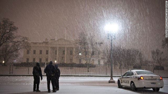 Police officers stand guard in front of the White House as a heavy snow storm hits Washington D.C. on February 13, 2014. The eastern US, in the grips of one of the most brutal winters in recent memory, braced for what forecasters warned could be the worst broadside yet -- a massive storm with the season's heaviest snowfall. AFP PHOTO / MLADEN ANTONOV (Photo credit should read MLADEN ANTONOV/AFP/Getty Images)