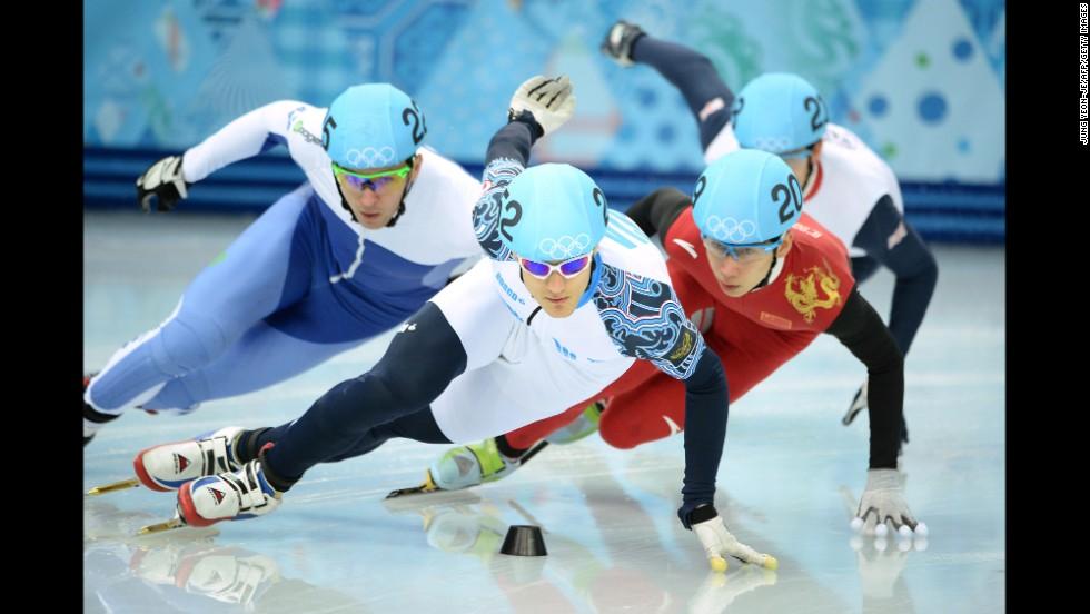 From left, Israel's Vladislav Bykanov, Russia's Vladimir Grigorev, China's Han Tianyu and Great Britain's Richard Shoebridge compete in a 1,000-meter short track speedskating race on February 13.
