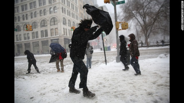 NEW YORK, NY - FEBRUARY 13:  A man braces his umbrella while walking through the snow on February 13, 2014 in New York City. Heavy snow and high winds made for a hard morning commute in the city.  (Photo by John Moore/Getty Images)