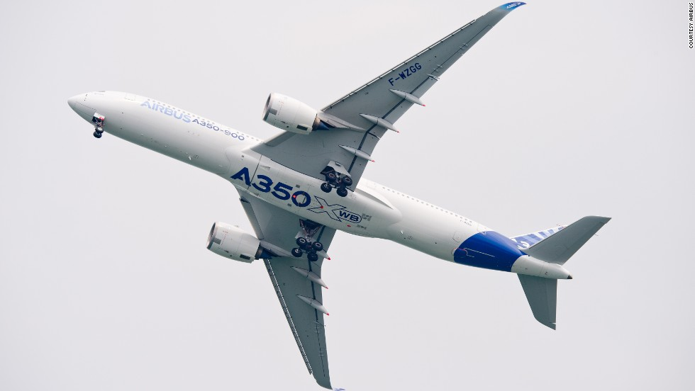 Airbus put one of its A350 test planes on display at the Singapore Airshow this week, giving journalists and officials a look inside the new fuel-efficient, extra wide bodied passenger jet. For now, only crew and mechanics are allowed aboard while the plane is in flight.
