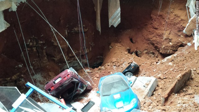 See sinkhole swallow Corvettes