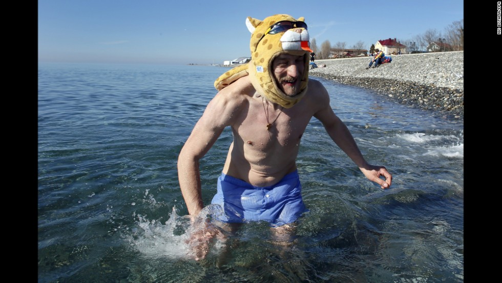 A man swims in the Black Sea, outside the Olympic Park, on February 13.