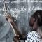 Ivory Coast school girl writing