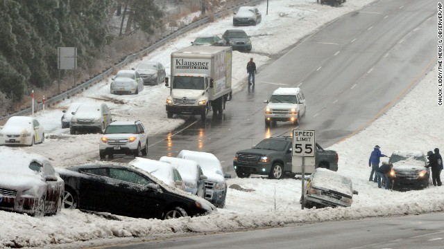 Wrecked and abandoned vehicles litter a highway near Raleigh,North Carolina, on Thursday February 13.