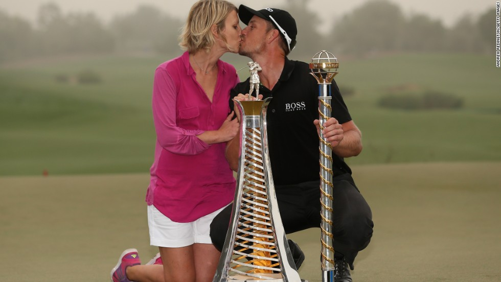 Stenson and his wife Emma enjoy a kiss on the 18th green following his win at the DP World Tour Championship in Dubai in November. The win ensured he finished top of the tree in Europe in 2013.