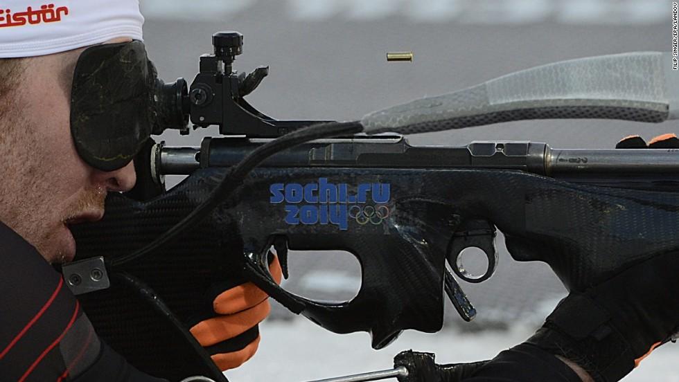 Simon Eder of Austria takes aim Thursday, February 13, during the men's 20-kilometer biathlon.
