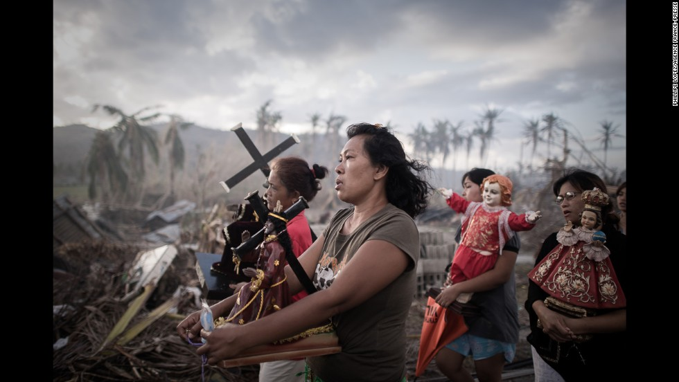 <strong>1st Prize Spot News Single: </strong>Survivors of Super Typhoon Haiyan march during a religious procession in Tolosa, Philippines. One of the strongest cyclones ever recorded, Haiyan left 8,000 people dead and missing and more than 4 million homeless in the central Philippines.