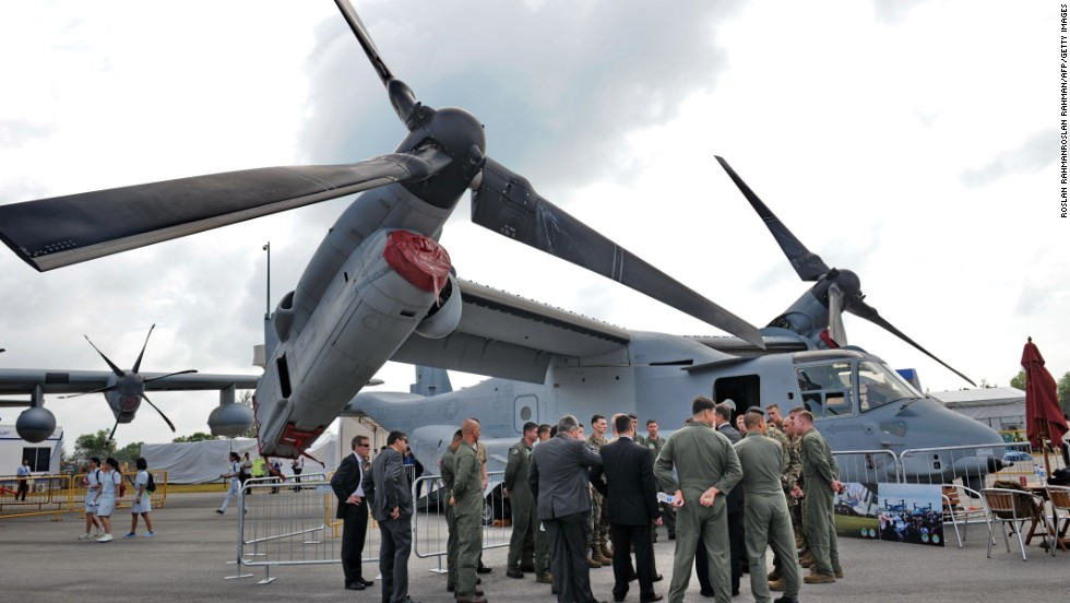 USAF personnel gather for a briefing next to the Marine Corps' MV-22B Osprey on February 13. It's the world's first production tilt-rotor aircraft.