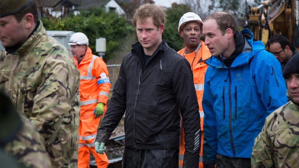 Prince Harry, in black, and Prince William, in blue, join members of the British Armed Forces to help defend the village of Datchet, England, from flooding on Friday, February 14. Nearly 6,000 homes in southern England have been flooded since the beginning of December.