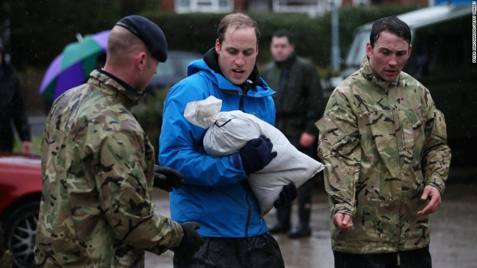 Prince William helps near a gas station in the center of Datchet, which is west of London.