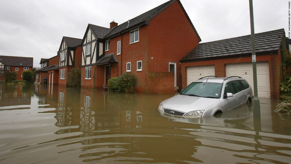 A car is half-submerged in floodwater near Staines-Upon-Thames, England.