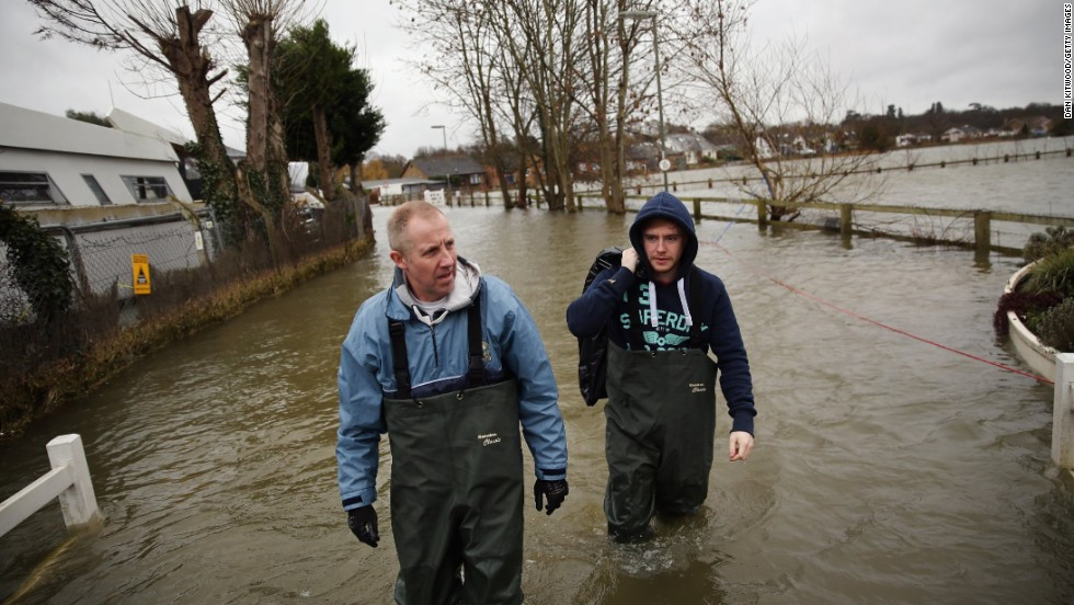 Residents collect possessions from their home next to the River Thames in Shepperton, England.