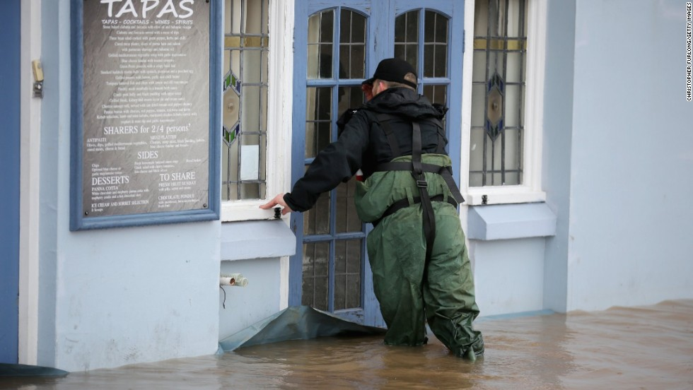 A police officer checks flooded properties in Worcester, England.