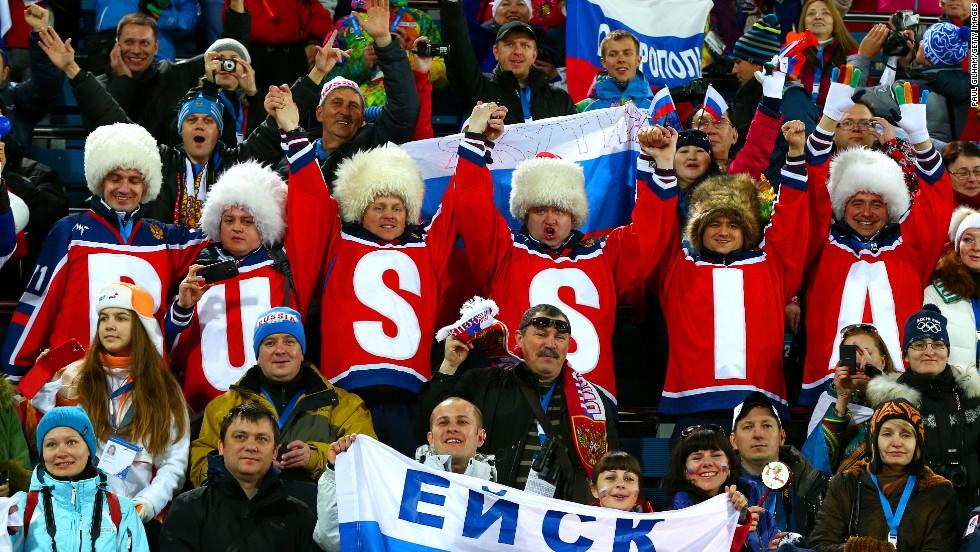 Russian fans watch the women's 15-kilometer biathlon on February 14.