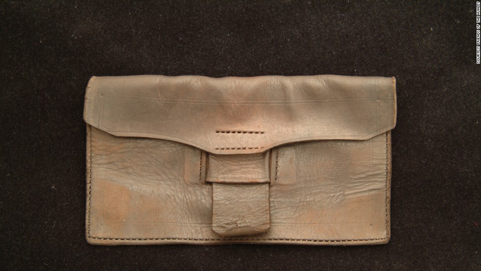 A wallet found in the shipwreck helps tells the story of ordinary life onshore.
