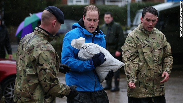 Prince William, Duke of Cambridge, helps with flood defenses on February 14, 2014 in Datchet, United Kingdom.