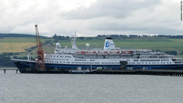 Cruise ship virus outbreak.File photo dated 07/07/09 of an ambulance visible in front of the Transocean Tours operated Marco Polo, berthed in Invergordon, Easter Ross. The Marco Polo, which abandoned its round-Britain cruise after around 400 people fell ill with the norovirus, docked at Tilbury, Essex, today. More than 600 passengers have started making their way home but 11 who are still recovering from the illness will leave the ship later, a spokesman for the ship said. Issue date: Saturday July 11, 2009. The ship will stay in Tilbury until July 14 and in conjunction with the Port of London health authority, the vessel will undergo a full sanitisation programme. See PA story HEALTH Virus. Photo credit should read: Andrew Hamilton/PA Wire URN:7559766