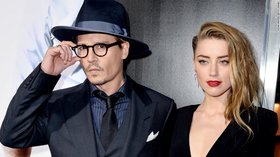 "Johnny Depp and his fiancée Amber Heard displayed their relationship in a very public way February 12 at the premiere of Heard's new movie, ""3 Days to Kill."" Depp is said to be head over heels for Heard, but the 27-year-old star isn't the first woman to steal Depp's heart. See what other famous names have been attached to Depp's:"