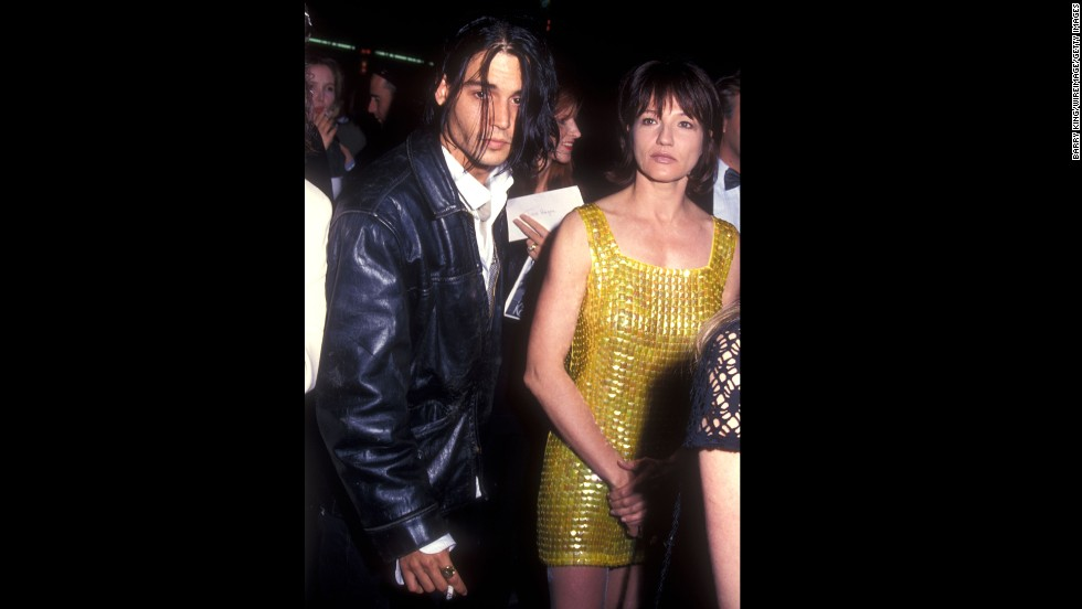 "Another one of Depp's co-stars, this time Ellen Barkin of ""Fear and Loathing In Las Vegas,"" was rumored to be romantically involved with the actor in the early '90s. Here they're seen in Los Angeles in 1994."