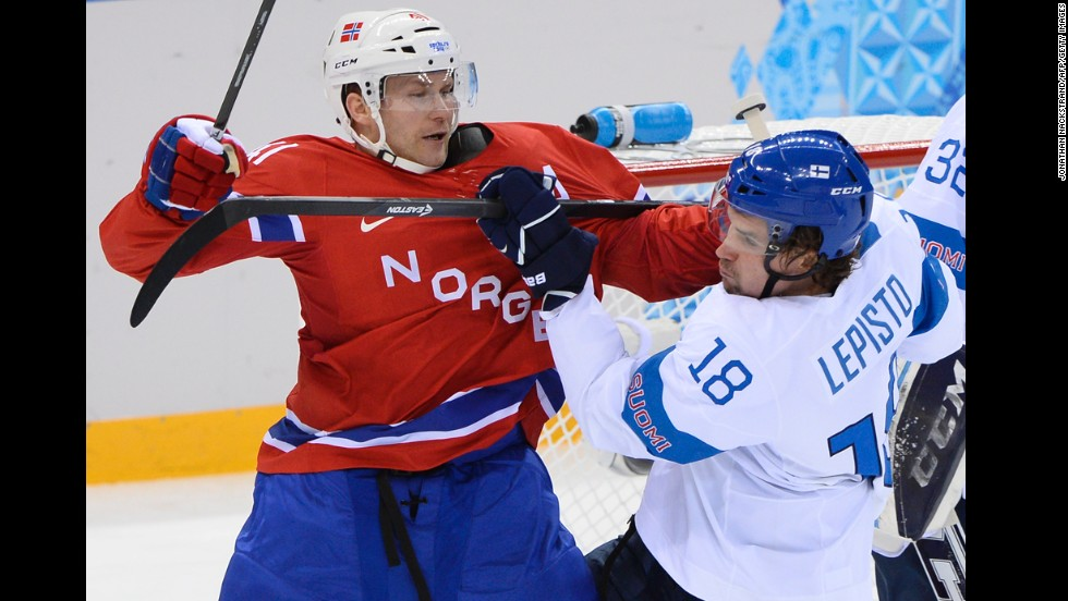 Finland's Sami Lepisto vies with Norway's Patrick Thoresen during the men's ice hockey game on February 14.