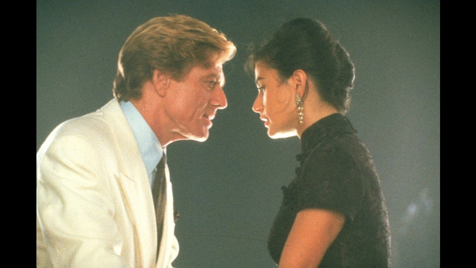 "<strong>""Indecent Proposal""</strong>: Would you risk your marriage for $1 million and a one-night stand with a wealthy older man? Robert Redford is the proposer and Demi Moore the target of his affections. <strong>(Hulu) </strong>"
