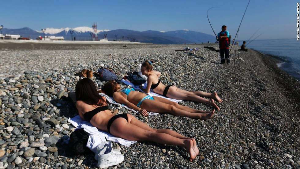 Women sunbathe by the Black Sea outside the Olympic Park during the 2014 Olympic Games in Sochi, Russia, on Saturday, February 15. Sochi, one of the southernmost cities in Russia, has seen temperatures over 60 degrees Fahrenheit during the Winter Olympic Games, and people are taking advantage of it.