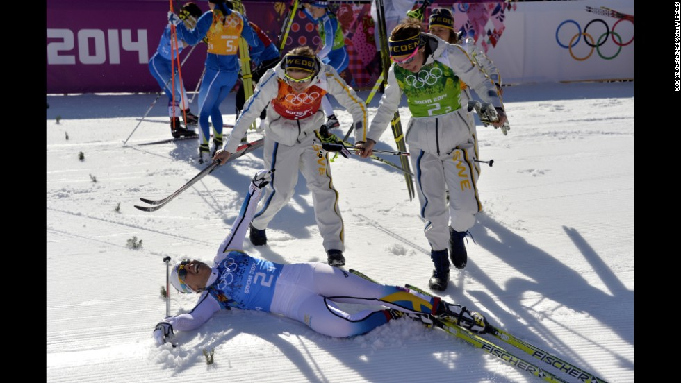 Sweden's Ida Ingemarsdotter, Emma Wiken and Anna Haag jump on teammate Charlotte Kalla after winning gold February 15 in the women's cross-country relay.