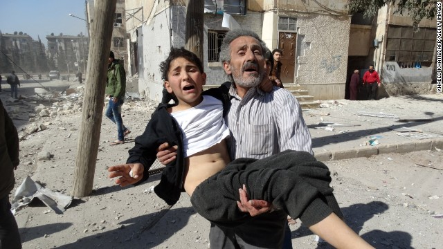 A Syrian man carries a wounded child following a reported air strike attack by government forces on the outskirts of the northern Syrian city of Aleppo on February 14, 2014. More than 136,000 people have been killed in Syria's brutal war since March 2011, and millions more have fled their homes