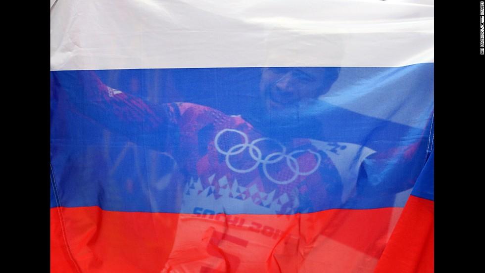 Alexander Tretiakov of Russia celebrates winning the men's skeleton final on February 15.